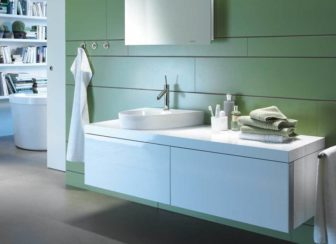 This sage green scheme provides a soft canvas for the Duravit Starck 2 basin & WC