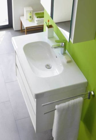 A zesty lime backdrop is ideal for Duravit's D-Code basin & Ketho cabinet