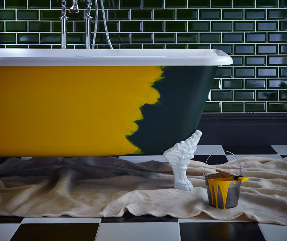 Roll top cast iron bath - partly repainted